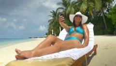 Cheerful young woman taking selfies on exotic beach in Maldives Stock Footage