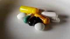 Medicine drugs pills capsule turning Stock Footage