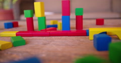 Panning over colorful building blocks on table Stock Footage