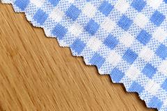 blue fabric of scots pattern on wooden. - stock photo