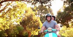 Couple loving the sights on a scooter road trip - stock footage