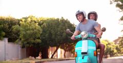 Young couple having a road trip together on their scooter - stock footage