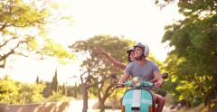 Couple road tripping on their scooter feeling free Stock Footage