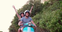 Couple road tripping on their scooter feeling free - stock footage