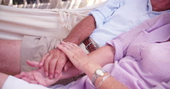 Senior couple holding hands lovingly - stock footage
