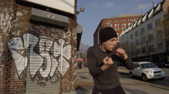 Boxer sparring throwing punches outside graffiti gritty NYC 4k Stock Footage