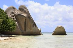 Beautiful huge granite boulders on the beach Anse Source DArgent - stock photo