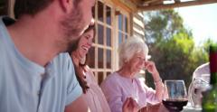 laughing Woman at a table during a family dinner - stock footage