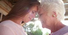 Senior woman and her loving adult daughter outdoors Stock Footage