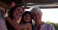 Little girl with her mother and grandmother - stock footage
