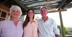 Senior couple with their adult daughter smiling for a portrait - stock footage