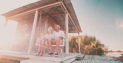 Retired senior couple holding hands in their porch swing Stock Footage