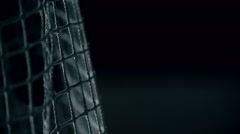 Macro shot of puck flying into gates in slow motion Stock Footage