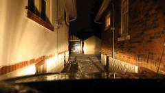 Wet winter night. Tight squeeze between two houses. East York, Toronto, Canada. Stock Footage