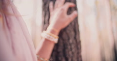Woman's hand with jewelry and temporary tattoo in forest Stock Footage