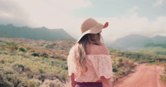 Boho girl walking on a dirt road in summer Stock Footage