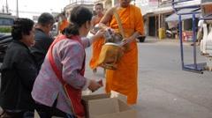 Monks collecting alms,Savannakhet,Laos - stock footage