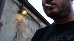 Man lights Cigarette Stock Footage
