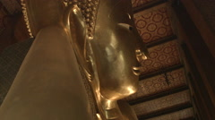 Gold Buddha Statue in Temple of the Reclining Buddha (Wat Pho), Bangkok Thailand Stock Footage