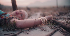 Boho girl lying on the ground in vintage floral dress Stock Footage
