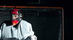 Close up of hockey goalkeeper catching puck in glove Stock Footage