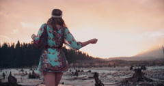 Boho girl walking at sunset Stock Footage