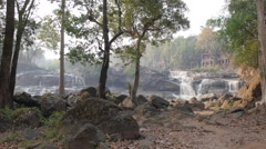 Waterfall with trees and rocks,Tad Lo,Laos Stock Footage