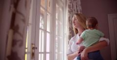 Sad Mother with her baby boy at home - stock footage