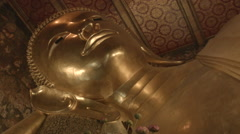 Gold Buddha Statue in Temple of the Reclining Buddha (Wat Pho), Bangkok Thailand - stock footage