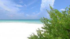 Untouched white sand and blue lagoon on exotic island - stock footage