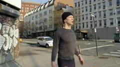 Fitness man jumping jacks in 4k slow motion Manhattan west side NYC Stock Footage