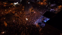 Flying over the stage and spectators at the concert at the city center square. Stock Footage