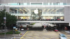 Busy traffic and apple store building in modern city, time lapse. - stock footage