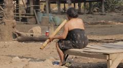 Woman smoking a big pipe,Tad Lo,Laos Stock Footage