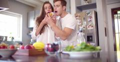 Boyfriend stealing his girlfriend's muffin in the morning - stock footage