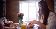 Couple enjoying a fresh healthy breakfast together - stock footage