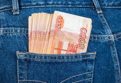 Russian rouble banknotes in the back jeans pocket - stock photo