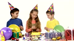 Group of happy children celebrating birthday: Preparing for the holiday Stock Footage
