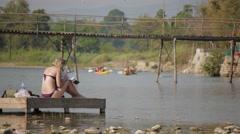 Tourists at the river shore,Vang Vieng,Laos Stock Footage