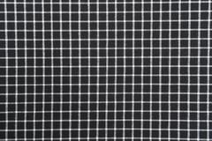 Black and white gingham cloth background with fabric texture Stock Photos