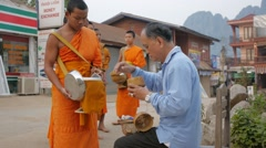 Monks collecting alms,Vang Vieng,Laos Stock Footage