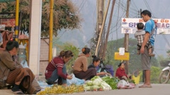 Early morning market on the streets,Vang Vieng,Laos Stock Footage