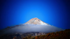 Unesco Mt. Teide obscured by fast moving mist clouds Pico del Teide National Stock Footage