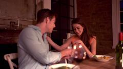 Loving man proposing with engagement ring to girlfriend - stock footage