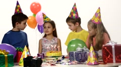 Сompany children waiting until girlfriend make a wish and blow out the candles Stock Footage