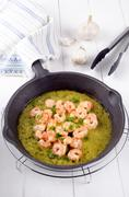 Scampi with melted butter and parsley Stock Photos