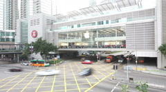 Busy traffic and apple store building in modern city, time lapse. Stock Footage
