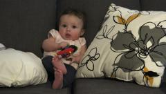 Baby Seated Playing With Toys Stock Footage