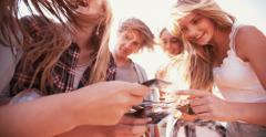 Group of teens sharing instant photographs Stock Footage