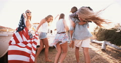 Stock Video Footage of American teens walking with flag into sun flare